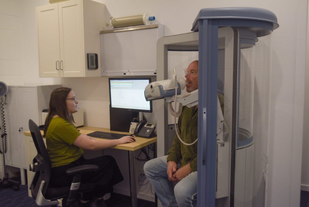 Man at a sleep clinic doing Pulmonary Lung Function Testing (PFT)